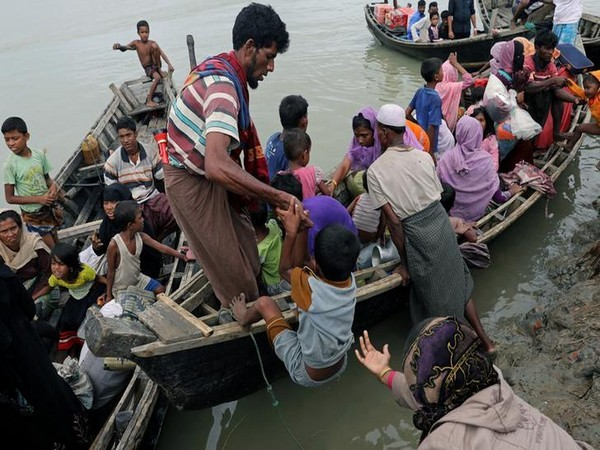 Rohingya refugees who arrived in Shah Porir Dwip from Myanmar last night, get into a boat to go to the mainland, in Teknaf, Bangladesh October 7, 2017. REUTERS/Mohammad Ponir Hossain